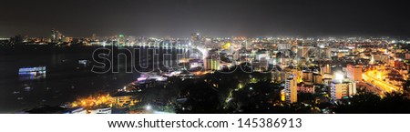 Panorama of Pattaya at night. Pattaya is a most popular tourist attraction in Thailand - stock photo