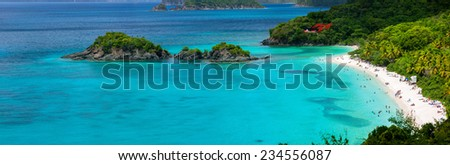 Panorama of picturesque Trunk bay on St John island, US Virgin Islands considered by many as most beautiful beach in Caribbean - stock photo