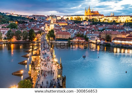 panorama of Prague with red roofs from above summer day at dusk, Czech Republic - stock photo