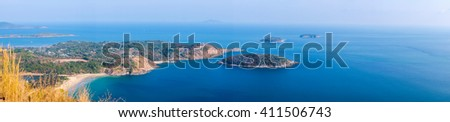 Panorama of promthep cape Phuket from high hill (Black rock hill Phuket) - stock photo