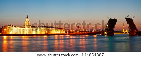 Panorama of quays of St.-Petersburg and the raised bridge at white night - stock photo