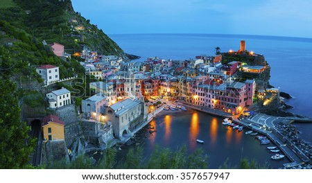 Panorama of resort village Vernazza, Cinque Terre, Italy at dusk - stock photo