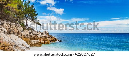 Panorama of seascape with greek Marble Beach in Thassos Island, Greece with turquoise water and pine trees - stock photo