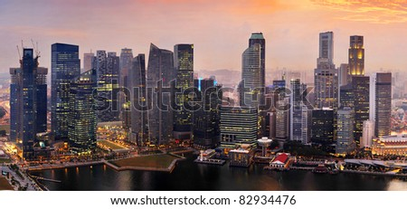 Panorama of Singapore from Marina Bay Sand Resort at beautiful sunset - stock photo