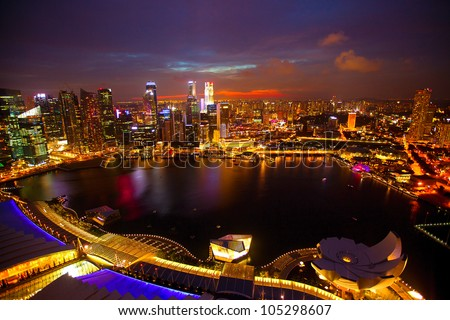 Panorama of Singapore from roof Marina Bay hotel, in the night. - stock photo