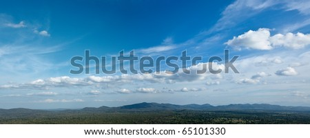 Panorama of sky above small mountains, covered with trees. Sri Lanka - stock photo