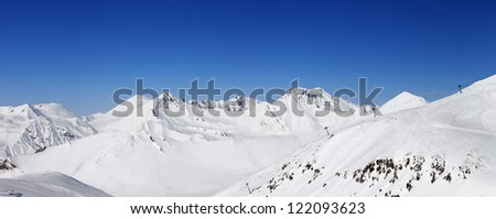 Panorama of snow winter mountains. Caucasus Mountains, Georgia, ski resort Gudauri. - stock photo
