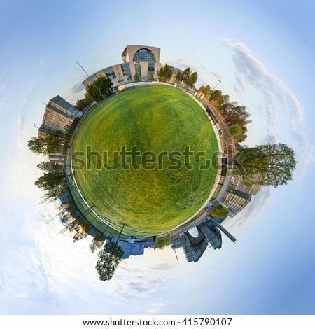 panorama of Spreebogen park in Berlin with government buildings in Berlin in early morning light - stock photo