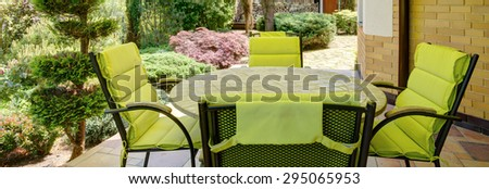 Panorama of stylish verandah with garden furniture - stock photo