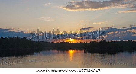 panorama of summer sunset on forest lake - stock photo