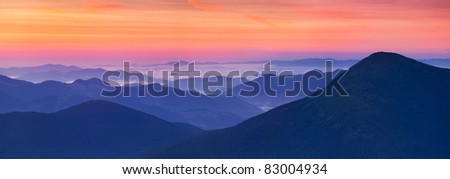 panorama of sunrise in the mountains - stock photo
