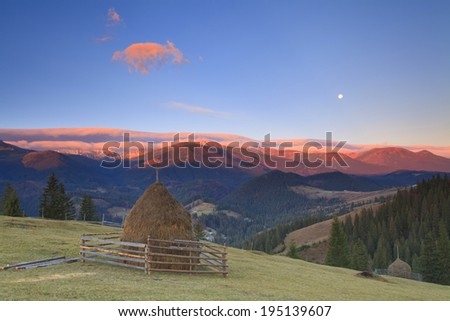 Panorama of sunrise in the mountains of with the Moon - stock photo