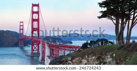 "Panorama of the bridge ""Golden Gate"" in San Francisco at sunset. California, USA - stock photo"