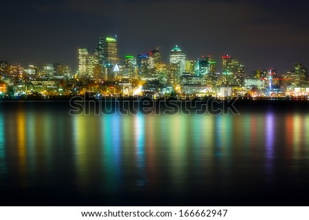 panorama of the city at night reflected in water, Seattle, USA - stock photo
