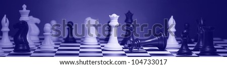 Panorama of the composition chess pieces on board - stock photo