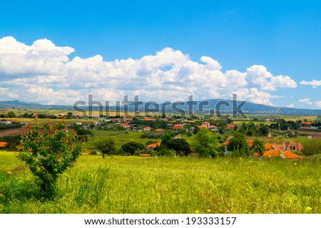 Panorama of the countryside Chalkidiki peninsula  with green field in foregroun - stock photo