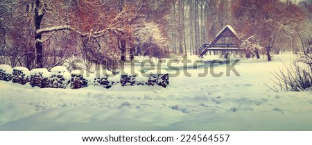 Panorama of the first snowfall in the city park. Retro style. - stock photo
