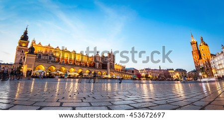 Panorama of the main old town market of Cracow. View to the Cloth Hall and St. Mary's Basilica. - stock photo