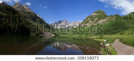 Panorama of the Maroon Bells reflected in Maroon Lake near Aspen, Colorado. - stock photo