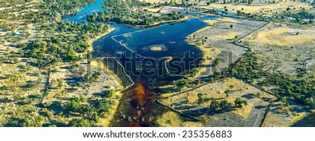 Panorama of the Okavango delta (Okavango Grassland) is one of the Seven Natural Wonders of Africa (view from the airplane) - Botswana, South-Western Africa - stock photo