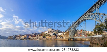 Panorama of the Ribeira District, the Douro River and iconic Dom Luis I bridge in the city of Porto, Portugal. Unesco World Heritage Site - stock photo