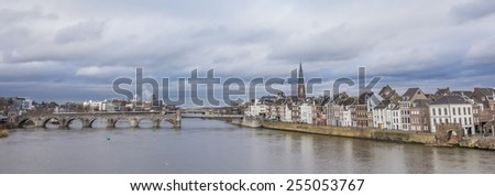 Panorama of the Servatius bridge and old center of Maastricht, Holland - stock photo