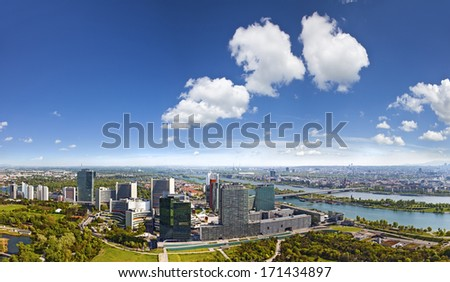Panorama of the Skyline of Danube City Vienna with the famous UNO City. At the left the Danube, at the right and the Donaupark in front. - stock photo