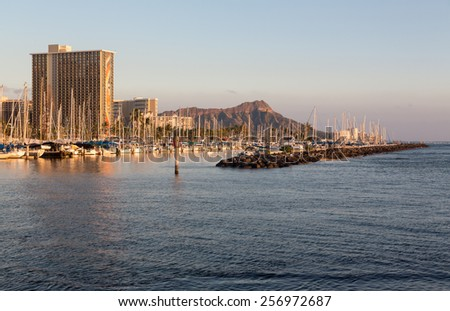 Panorama of the skyline of Waikiki at sunset or dusk with yachts and boats in Ala Moana harbor and Hilton Hawaiian Village framing Diamond Head in Waikiki, Oahu, Hawaii - stock photo