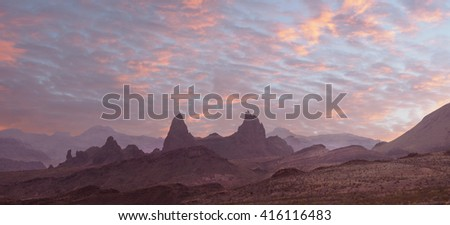 Panorama of the Sunset Over the Mule Ears, Big Bend National Park - stock photo