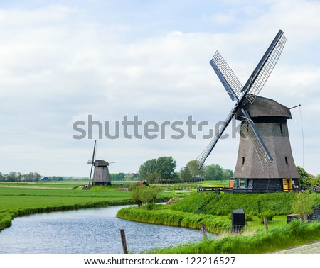 Panorama of the traditional Dutch windmill near the channel. Netherlands. Panorama - stock photo