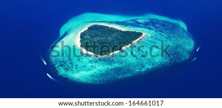 Panorama of the tropical island, view from airplane - stock photo