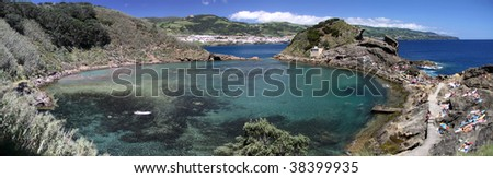 Panorama of the volcanic crater pool Illheu de Vila Franca near the coast of Sao Miguel (Azores) - stock photo
