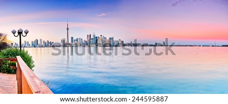 Panorama of Toronto City reflected on the lake. - stock photo