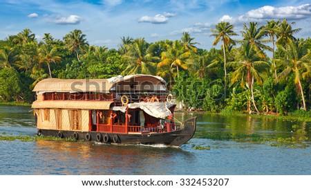 Panorama of tourist houseboat on Kerala backwaters. Kerala, India - stock photo