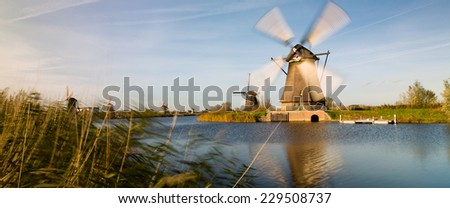 Panorama of traditional setting of the historical dutch windmills landscape at Kinderdijk near Rotterdam, the Netherlands, an UNESCO world heritage site - stock photo