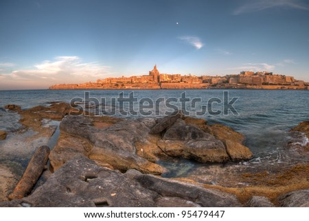 Panorama of Valletta taken from the shore of Manoel Island. - stock photo