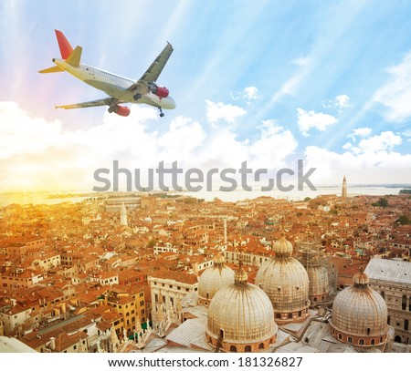 Panorama of Venice from above with passenger tourist plane going to land - stock photo