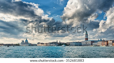 Panorama of Venice from the Giudecca Canal looking across the water from the Basilica Santa Maria della Salute to the Doges Palace - stock photo