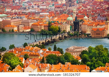 Panorama of Vltava and Charles Bridge from above on sunny day - stock photo