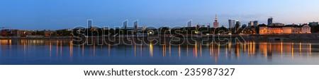 Panorama of Warsaw at dusk - stock photo