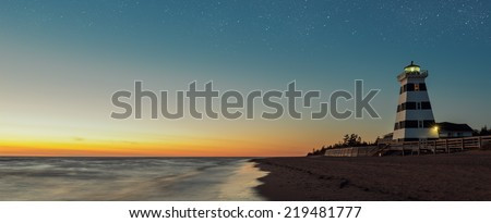 Panorama of West Point Lighthouse at Dusk (North Cape Coastal Drive, Prince Edward Island, Canada) - stock photo