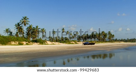 Panorama of wild beach in South Goa with traditional indian fishing boat . South Goa. India - stock photo