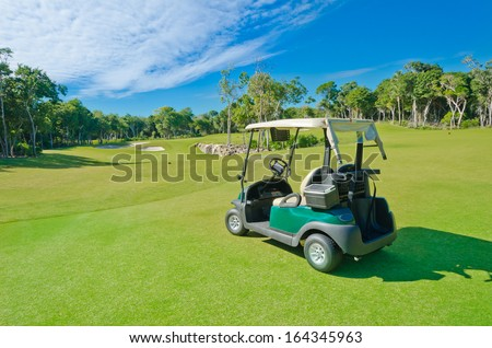 Panorama, outlook at the beautiful golf course with the golf cart at the sand bunkers. Luxury mexican resort. - stock photo