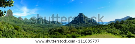 Panorama overview over Rotui mountain with Cook's Bay and Opunohu Bay on the tropical pacific island of Moorea, near Tahiti in French Polynesia. - stock photo