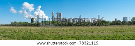 panorama shot of an oil refinery at the Rotterdam harbor - stock photo