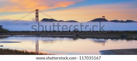 Panorama shot of Golden Gate Bridge at sunset. San Francisco, USA. - stock photo