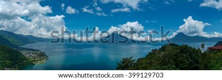 Panorama shot of Lake Atitlan and  surrounding volcanos - stock photo