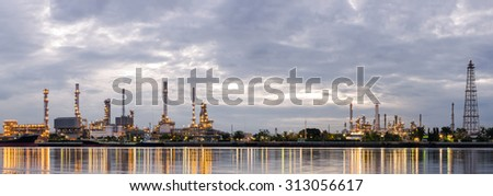 PANORAMA , Sunrise, oil refinery factory industry plant at twilight morning with reflection on the river. - stock photo