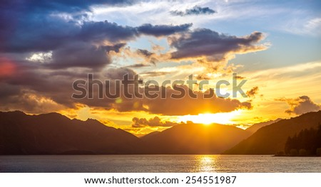Panorama Sunset Lake Wakatipu in Queenstown, New Zealand - stock photo