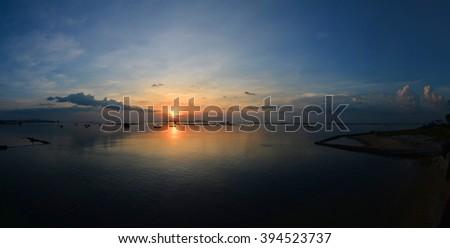 panorama, Sunset on the beach with beautiful sky - stock photo